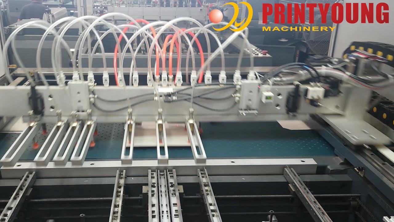 Автоматическая машина для изготовления бумажных футляров для телефона