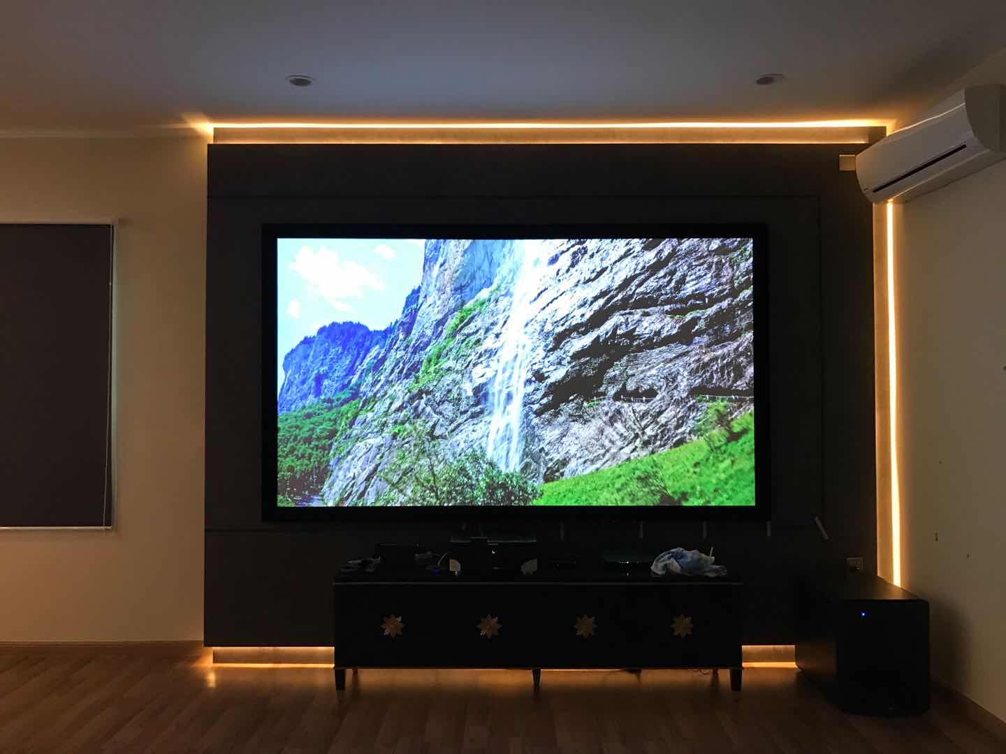 Epson EH-TW7000 with HK80C series 4k woven acoustically transparent fixed frame projection screen